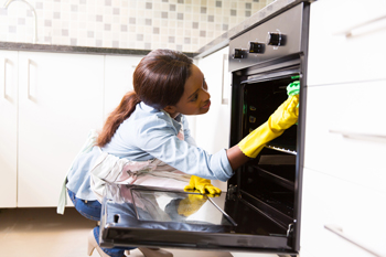 woman-cleaning-stove_350px